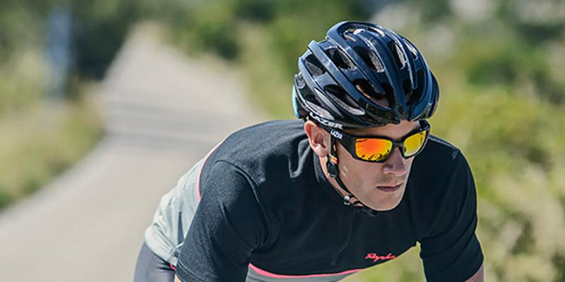 Photo of a man cycling with a black bike helmet