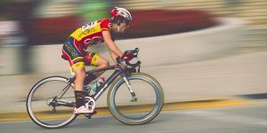 Photo of a racing cyclist cornering at speed
