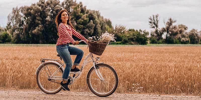 Photo of a woman riding a very relaxed geometry dutch bike