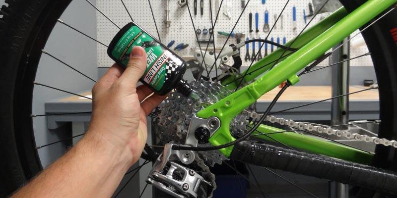 Photo of applying lube to a bike chain